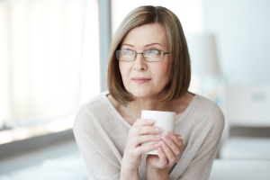 Portrait of calm mature woman with cup - for my Christian Ladies' Group